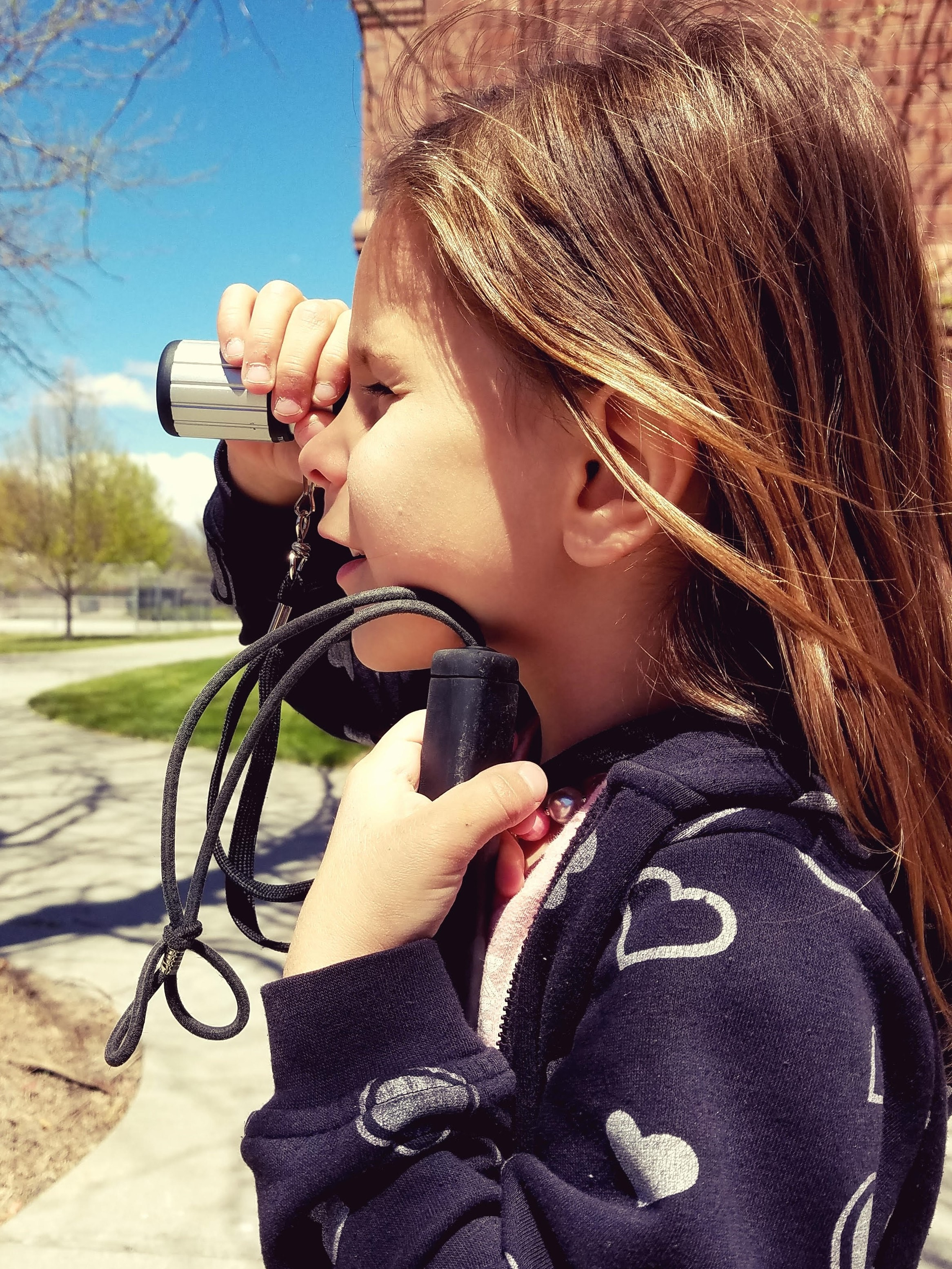 student using monocular device